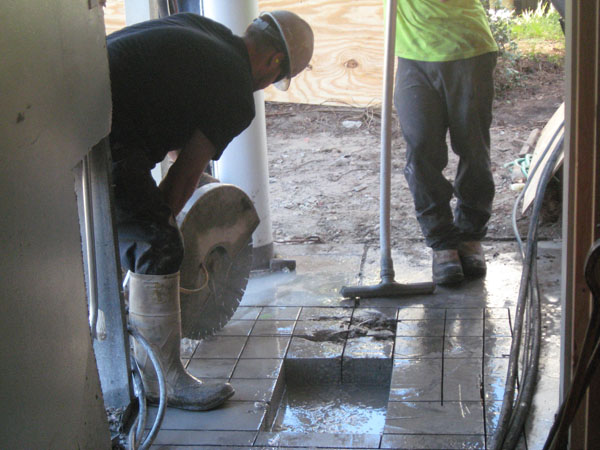 Cutting into existing Slab for new footings.