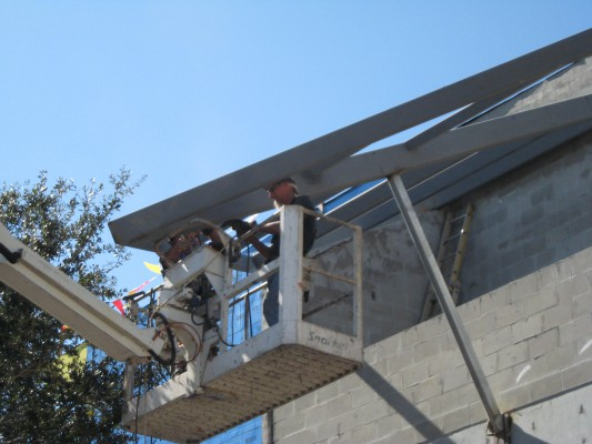 Welding stairwell canopies
