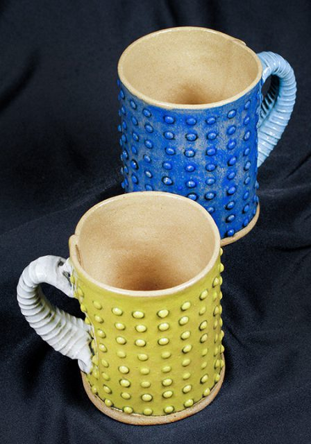 Ceramic mugs, like these made of paper clay by Corey McCrory, are available at the Dunedin Fine Art Center Gallery Shop.