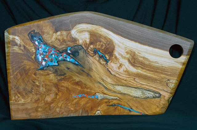 Tom Davis' wood charcutery board is among the many consignment items at the Dunedin Fine Art Center Gallery Shop.