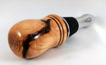 This Maple-Wine-Bottle-Stopper by Steve Axelrod is one of many wooden creations on consignment at the Dunedin Fine Art Center Gallery Shop.