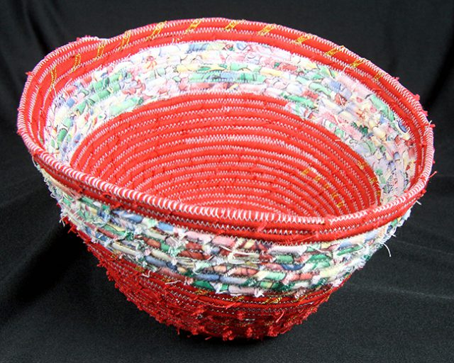 This woven basket by Carol Sackman is on of many fiber artwork on display inside the Dunedin Fine Art Center Gallery Shop.