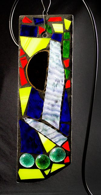 Glass artwork, like this stained glass by Holly Apperson, are available in the Gallery Shop at the Dunedin Fine Art Center.