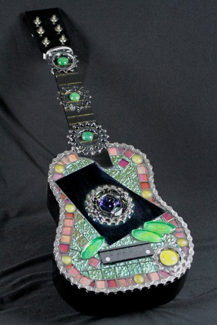 This glass mosaic guitar is on consignment at the Dunedin Fine Art Center Gallery Shop.