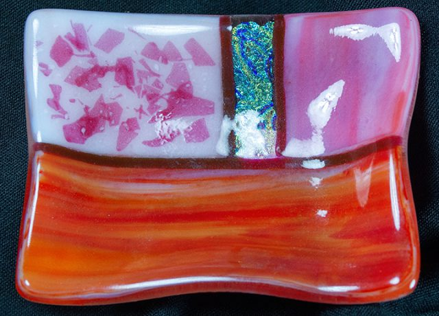A glass sushi dish by Paula Clancy is on consignment inside the Gallery Shop at the Dunedin Fine Art Center.